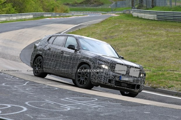 Гибридный BMW X8 вывели на трек